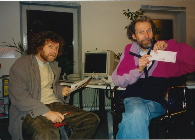 Shivananda and Bhikkhu in the first Munich office with tickets for a New Earth Records event with Hariprasad Chaurasia and Miten.  Chinmaya Dunster was the  'opening act'.  Early 1990's. Chinmaya lost a toe on stage at the show.